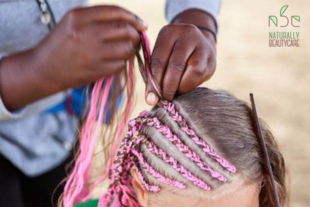 afro-american-hairdresser-made-plaits-in-african-style-for-young-caucasian-girl